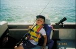 Andrew waiting in the boat for more fishing! or maybe he's asleep..