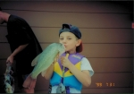 I guess 5 year olds don't know not to kiss the fish.