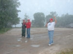 Our great friend and tournament volunteer, Steve Isom, releasing the boats at 7:00 a.m. Two guys in the background are J