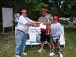 Steve Isom, representing the Nebraska Walleye Association (NWA), and presenting the 1st place winners in the 10 and unde