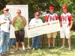 Mike, Brian and Joni Claymon presenting the University of Nebraska Husker Bass Angler team with a donation in memory of