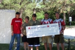 The Claymon family making their annual donation to the Husker Bass Angler fishing team in memory of Andrew.