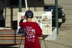 One of the young tournament participants looking at pictures and newspaper articles about Andrew.