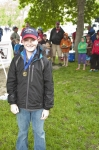 Sage Konicek and his fishing medal.