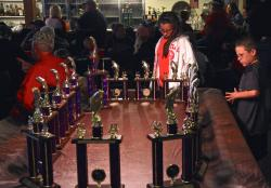 Kids admiring the trophies at the rules meeting/tournament dinner the night before the tournament.