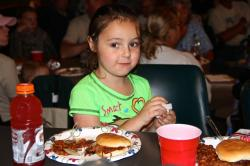 A young participant enjoying the tournament dinner.